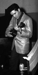 Elvis learning ukulele