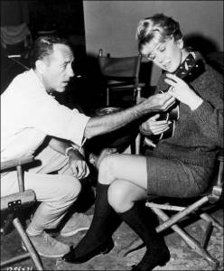 Doris Day gets a lesson from David Niven